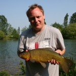 Dave and his new pb tench of 6lbs 3oz