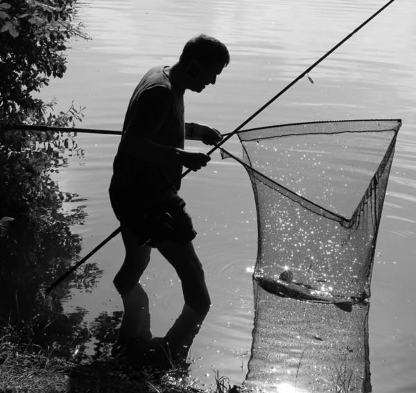 Paul landing a carp