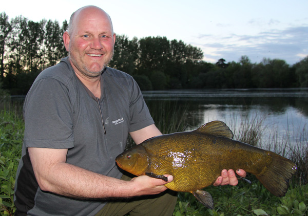 Dave and a new pb tench of 8lbs 4oz