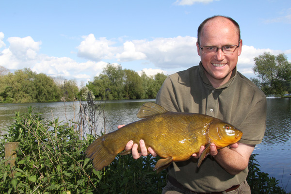 Jim with another 6lb plus tench in the late evening sun