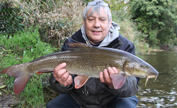 Rob with a 7lbs 2oz barbel
