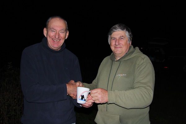 Colin receiving the best grayling award from Alan