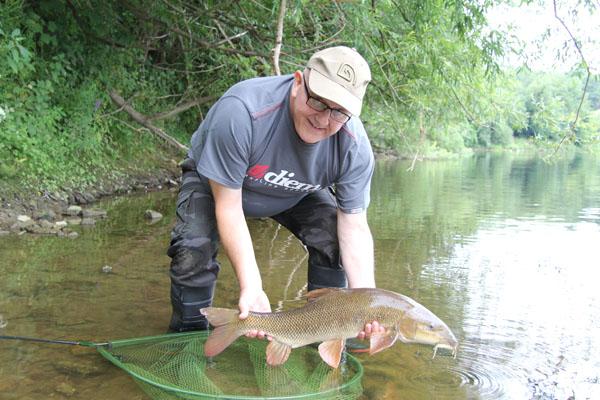 Bill returning a barbel