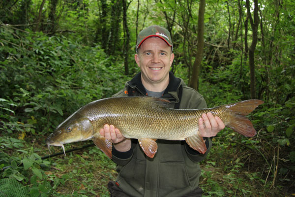 Dan and his first barbel 8lbs 14oz