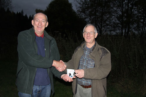 Colin presenting the best grayling cup to Tony